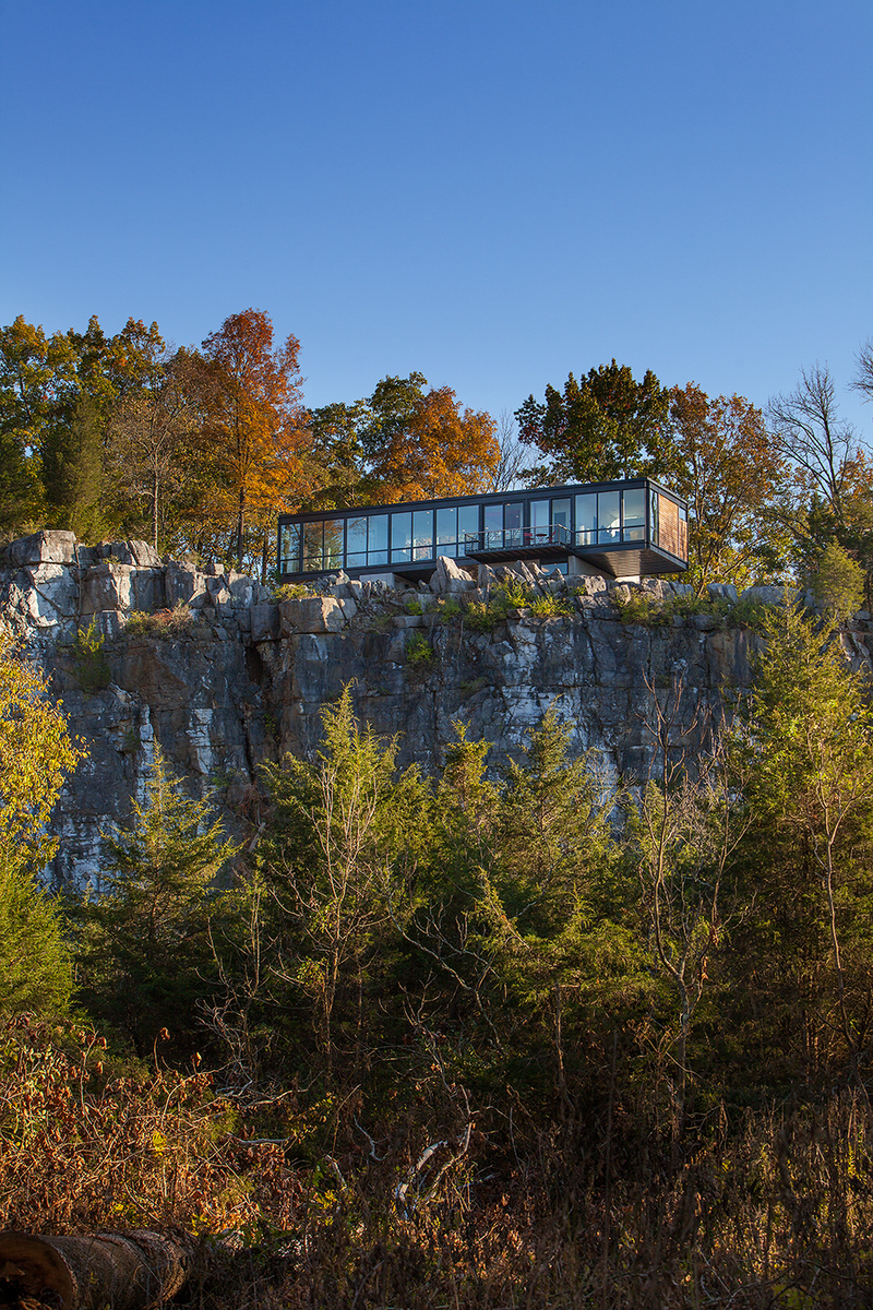 View of cliff side home from   river below .