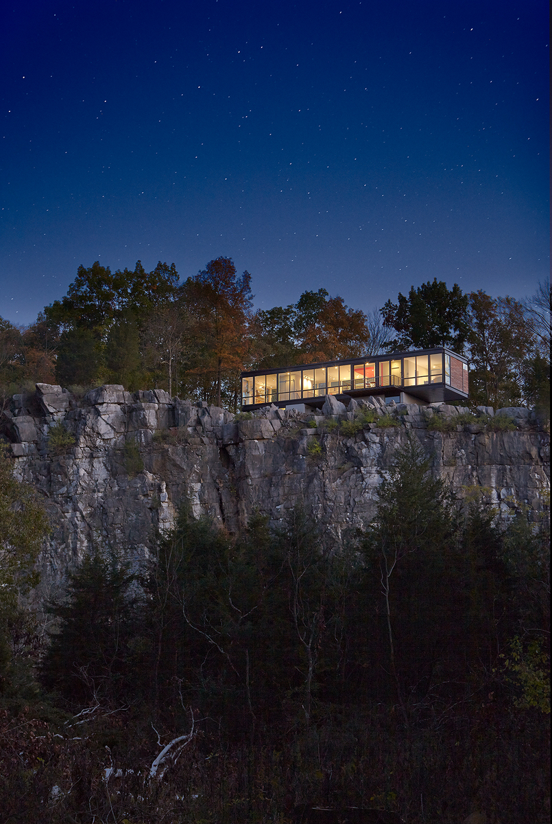 Cliff side view of home at night