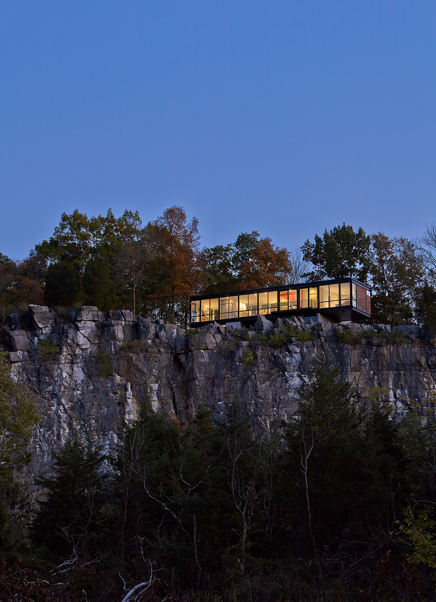 Cliff side view of home at dusk