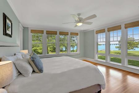 Master bedroom with views of river.