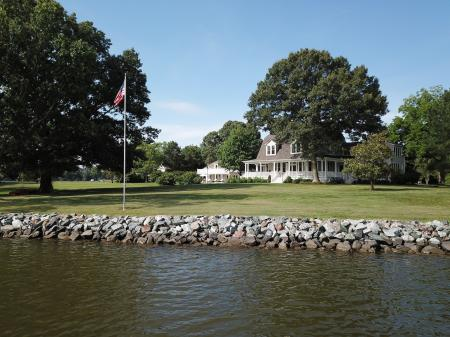 View of main house & pool house from water.